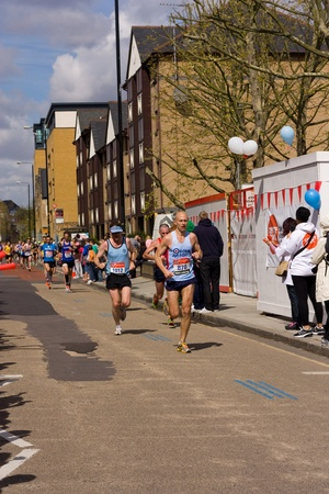 LONDON - APRIL 22: Unidentified people run the London marathon on April 22, 2012 in London, England, UK. The marathon is an annual event. Stock Photo - 13537518