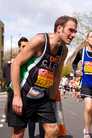 LONDON - APRIL 22: Unidentified people run the London marathon on April 22, 2012 in London, England, UK. The marathon is an annual event. Stock Photo - 13537180