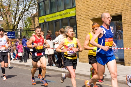 LONDON - APRIL 22: Unidentified people runs the London marathon on April 22, 2012 in London, England, UK. The marathon is an annual event. Stock Photo - 13537486