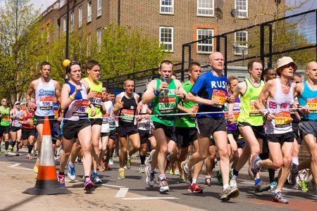LONDON - APRIL 22: Unidentified people runs the London marathon on April 22, 2012 in London, England, UK. The marathon is an annual event. Stock Photo - 13537545
