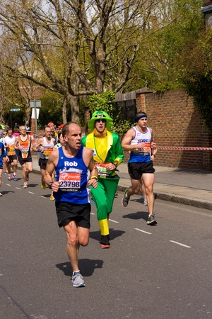 LONDON - APRIL 22: Unidentified people runs the London marathon on April 22, 2012 in London, England, UK. The marathon is an annual event.