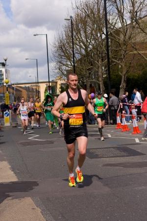 LONDON - APRIL 22: Unidentified man runs the London marathon on April 22, 2012 in London, England, UK. The marathon is an annual event.