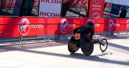 LONDON - APRIL 22: Unidentified wheelchair racers at the London marathon on April 22, 2012 in London, England, UK. The marathon is an annual event. Stock Photo - 13537195