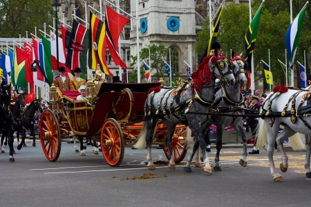 LONDON - JUNE 5: The Queens carriage procession  makes its way to Buckingham Palace during the Diamond Jubilee celebrations on June 5, 2012 in London, England, UK. The diamond Jubillee marks 60 years of the Queens reign. Editorial