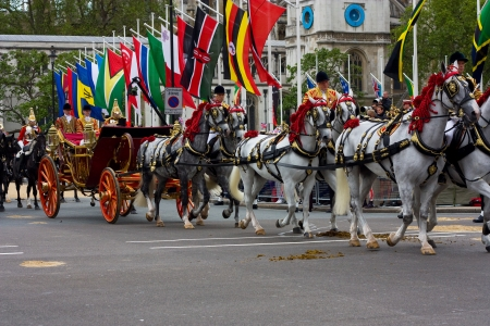 LONDON - JUNE 5: The Queens carriage procession  makes its way to Buckingham Palace during the Diamond Jubilee celebrations on June 5, 2012 in London, England, UK. The diamond Jubillee marks 60 years of the Queens reign.
