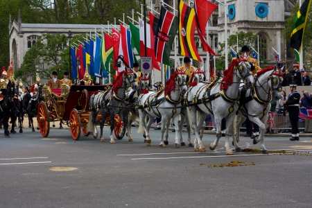 LONDON - JUNE 5: The Queens carriage procession  makes its way to Buckingham Palace during the Diamond Jubilee celebrations on June 5, 2012 in London, England, UK. The diamond Jubillee marks 60 years of the Queens reign