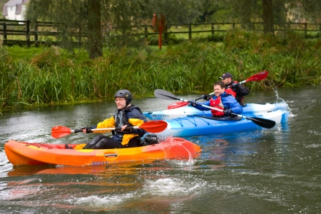 Bures, river stour - September 26th: Unidentified men enjoy canoeing on the 26th of september 2012 at Bures, england, uk