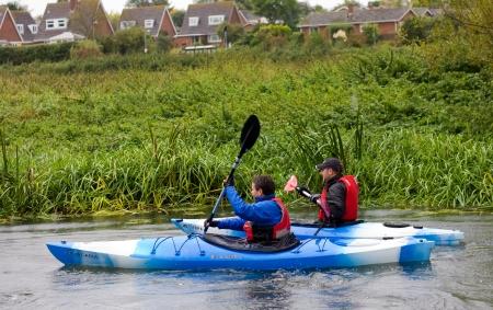 Bures, river stour - September 26th: Unidentified men enjoy canoeing on the 26th of september 2012 at Bures, england, uk