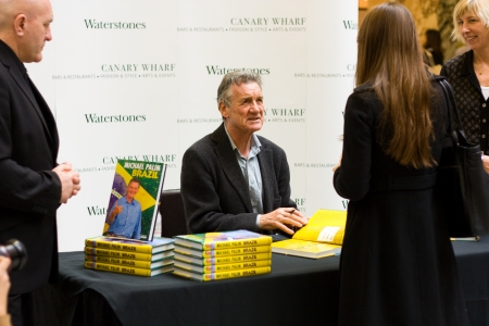 comedian: LONDON - NOVEMBER 21ST: Michael Palin autographs his book at canary wharf on the 21st of november, 2012 in London. Michael Palin is a famous  comedian, actor, writer and television presenter.