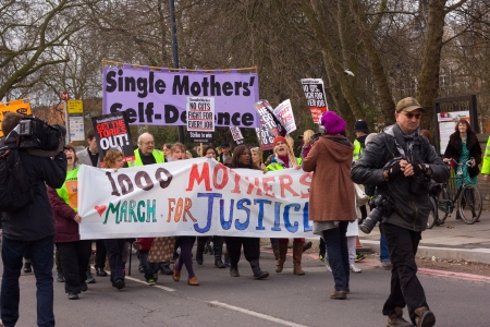 13th: LONDON - APRIL 13TH: Unidentified people protest at the Thousand Mothers March for Benefit Justice in Tottenham, London on April the 13th 2013.  The protest was to highlight how benefit changes would hit working women and mothers. Editorial