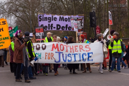 demonstrators: LONDON - APRIL 13TH: Unidentified people protest at the Thousand Mothers March for Benefit Justice in Tottenham, London on April the 13th 2013.  The protest was to highlight how benefit changes would hit working women and mothers. Editorial