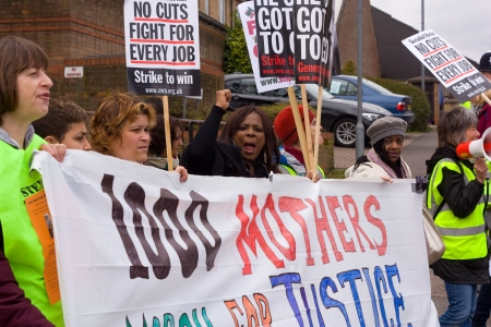 demonstrators: LONDON - APRIL 13TH: Unidentified people protest at the Thousand Mothers March for Benefit Justice in Tottenham, London on April the 13th 2013.  The bedroom tax effects the working class people.