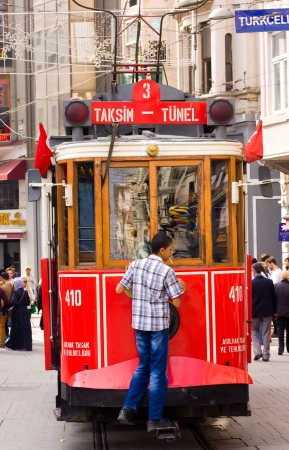 ISTANBUL, TURKEY - OCT 16TH 2013: A red heritage tram on the 16th of October 2013 in Istanbul, Turkey. The heritage tram was opened in 1990.