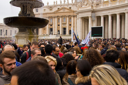 LONDON - JANUARY 26TH  Unidentified people gather in st peters square to see the pope on the 26th of january in Rome, Italy  The pope makes an appearance every sunday at 12 noon  Editorial