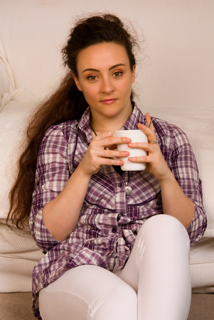 Young woman drinking coffee at home. photo