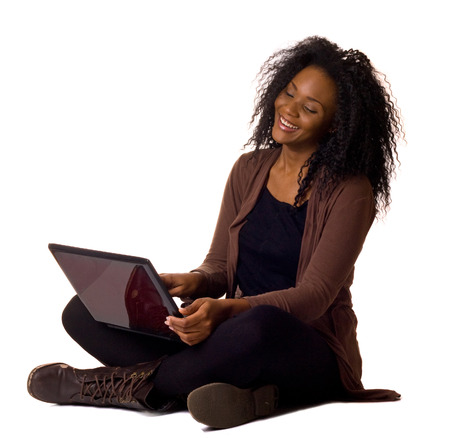 Happy young woman with laptop isolated on a white background.  photo