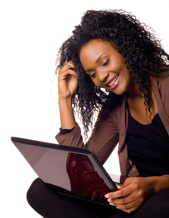 Happy young woman with a laptop computer isolated on a white background. photo