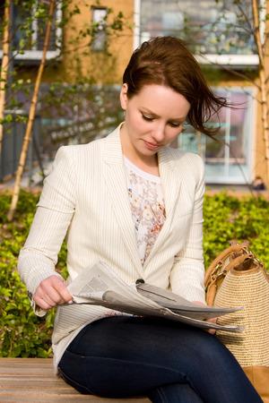 beautiful woman reading the newspaper photo