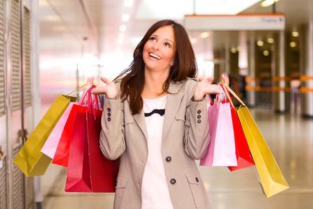 beautiful young woman shopping. photo