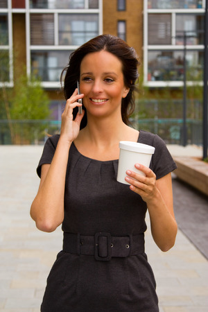 young woman talking on the phone and enjoying coffee. photo