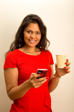 happy woman with phone and coffee photo