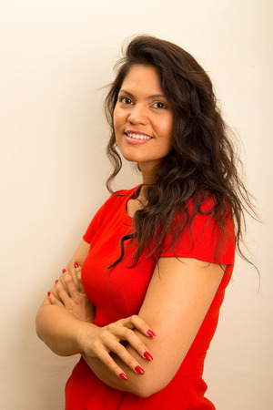 latina girl: young latina woman posing with crossed arms.  Stock Photo