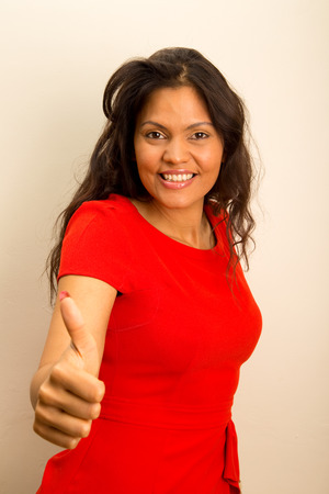 young woman showing thumbs up gesture. photo