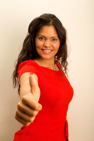 young woman showing thumbs up symbol. photo