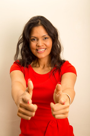 latina girl: beautiful latina pointing at camera.  Stock Photo