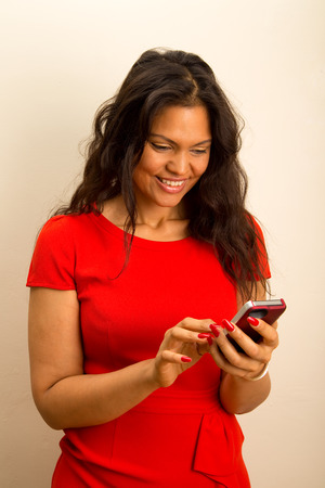 a beautiful young woman sending text messages.  photo
