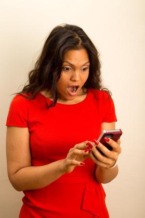 beautiful girl looks shocked at phone photo