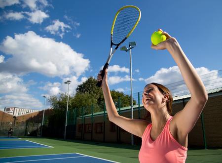 woman celebrating winning tennis match photo