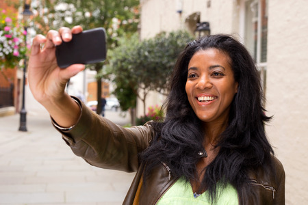 african american woman taking a selfie photo