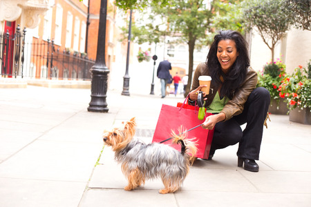 woman with dog and shopping bags. photo
