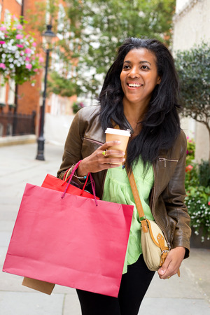 young woman with coffee bags and coffee photo