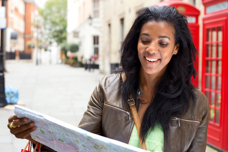 young woman looking at map in London photo