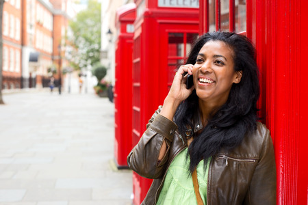 young woman with mobile phone in London photo