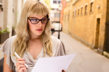 young woman reading a document photo