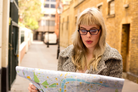 woman reading map Stock Photo