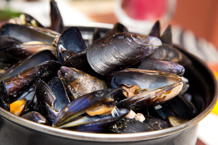 mussels served in a pot.