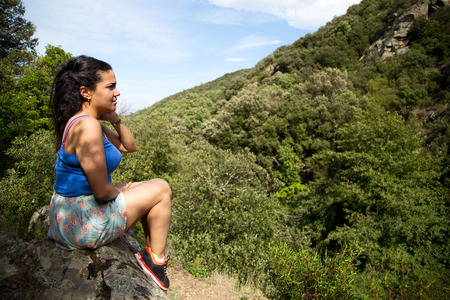 beautiful latina girl looking at a view. photo