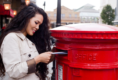 young woman posting letters photo