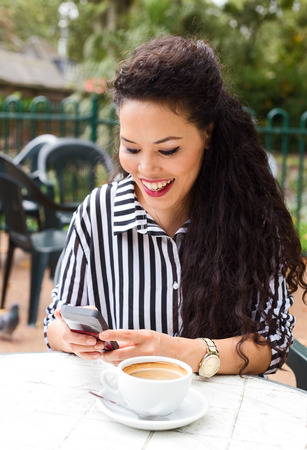young woman reading a text message photo