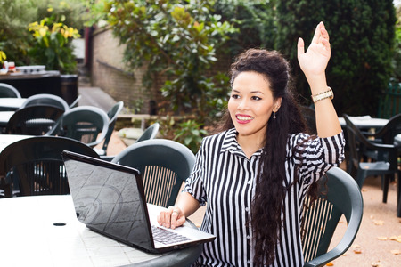 young business woman waving at someone photo
