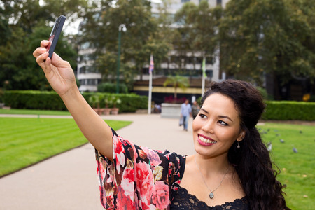 photo pictures: young woman taking a selfie