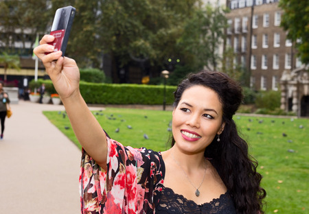 casual fashion: young woman taking a selfie.