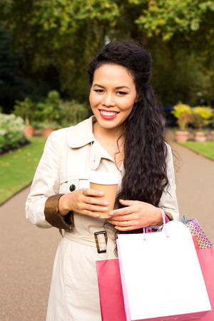 woman enjoying coffee with shopping bags. photo