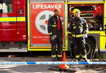 LONDON - OCTOBER 11TH: The fire brigade attend an emergency in waterloo on October 11th, 2014 in London, England, UK. London�s fire and rescue service is the busiest in the country