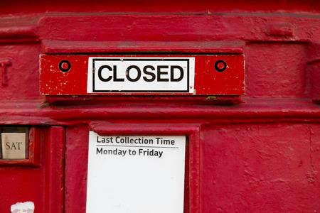 pillar box: a closed british red letterbox.