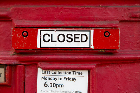 pillar box: a closed red letterbox.
